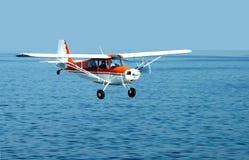 Fish Spotter. A fish spotter plane over the seas Stock Photo