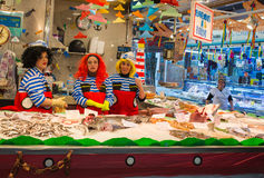 Fish stand at Santa Caterina market during carnival. At the neighbourhood market of Santa Caterina in Barcelona, the shopkeepers disguise themselves during Royalty Free Stock Photos