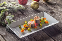 Fish starter food on white plate with christmas decoration. product photography and modern gastronomy Stock Image