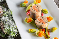 Fish starter food on white plate with christmas decoration. product photography and modern gastronomy Stock Photos