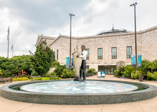 An With Fish Statue located outside the Chicagos Shedd Aquarium. Chicago, Illinois, USA - August 25, 2014: Man With Fish Statue located outside the Chicagos Stock Images