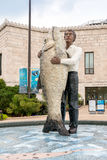 An With Fish Statue located outside the Chicagos Shedd Aquarium. Chicago, Illinois, USA - August 25, 2014: Man With Fish Statue located outside the Chicagos Stock Photography