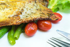 Fish steak. With chili sauce Royalty Free Stock Photo