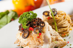 Fish steak. Decorated fish steak with pan fried spinach side with spaghetti on dish Stock Photo