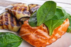 Fish steak with eggplant and spinach Royalty Free Stock Photos