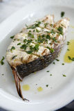 Fish steak grilled on the barbecue with herbs Stock Photography