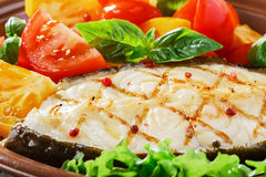 Fish steak grilled vegetables Stock Images