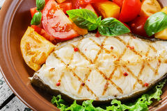 Fish steak grilled vegetables Stock Image