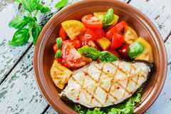 Fish steak grilled vegetables Royalty Free Stock Photo