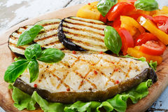 Fish steak grilled vegetables Royalty Free Stock Image