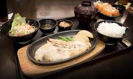 Fish Steak japan style. Fish Steak japan  food on wood table Royalty Free Stock Photography