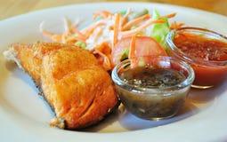 Fish steak with salad Stock Photos