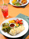 Fish steak with vegetables Royalty Free Stock Photos