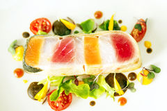 Fish steak with vegetables Stock Photos