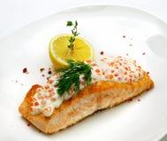 Fish steak. On a white background Stock Photos