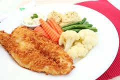 Fish steak on white plate Royalty Free Stock Photos