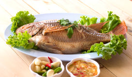 Fish.steamed fish chinese style on wooden Royalty Free Stock Photo