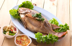Fish.steamed fish chinese style on wooden. And have garlic and chilli Royalty Free Stock Image