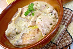 Fish stew in creamy sauce on ceramic pan Stock Images