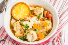 Fish stew with vegetables and rice, delicious healthy dinner stock images