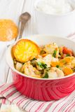 Fish stew with vegetables and rice, delicious healthy dinner stock image