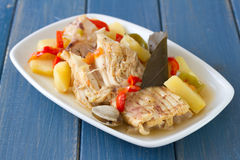 Fish stew on white dish Royalty Free Stock Images