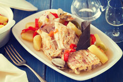 Fish stew on white dish with wine Stock Photos