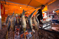 Fish-on-stick stall at New Years in Tokyo Royalty Free Stock Photography