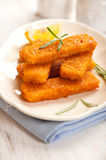 Fish Sticks. Closeup of fish sticks with rosemary on a plate Royalty Free Stock Photography