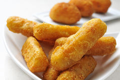 Fish sticks and croquettes. Some bowls with fish sticks and croquettes served as appetizer Stock Image