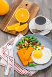 Fish sticks, fried egg and vegetables Stock Images