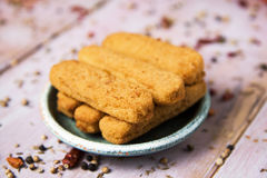 Fish sticks in a rustic plate Stock Images