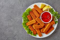Fish sticks served on a white plate royalty free stock photography