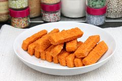 Fish sticks. Some frozen fish sticks on a plate Royalty Free Stock Images