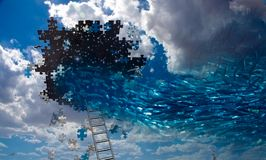 Fish swim into hole in the sky. Pieces of puzzle Royalty Free Stock Photo