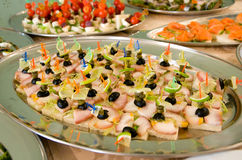 Fish table - tray with sturgeon canapes. On the forefround Royalty Free Stock Images