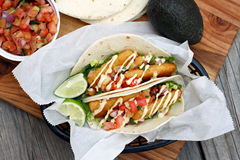 Fish Tacos. Battered fish tacos with avocado sauce and lime Royalty Free Stock Image