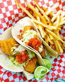 Fish Tacos. Picnic food, fried fish tacos on cute red and white checked paper Royalty Free Stock Photos