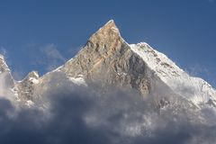 Fish Tail Peak Machapuchare surrounded by rising clouds, Himalayas stock photography