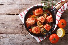 Fish in tomato sauce in a frying pan. horizontal top view Royalty Free Stock Photos