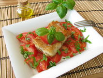 Fish with tomatoes royalty free stock images