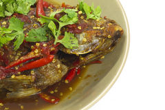 Fish topped with chili. Stock Photos