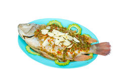 Fish topped with chili. Royalty Free Stock Photo