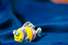 Fish toy on blue towel Royalty Free Stock Photos