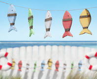 Fish Toys Handing by the Beach Stock Images