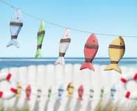 Fish Toys Handing by the Beach Stock Image