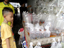 Fish. Traders sold the fish is placed in plastic in Madiun, East Java, Indonesia Royalty Free Stock Photo