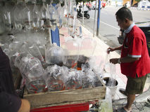 Fish. Traders sold the fish is placed in plastic in Madiun, East Java, Indonesia Stock Image
