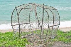 Fish trap on the beach. Stock Photo