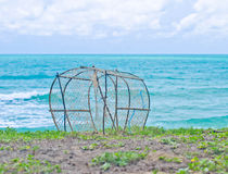 Fish trap on the beach. Royalty Free Stock Image